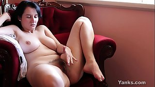 Busty dark brown aeryn masturbating her unshaved muff