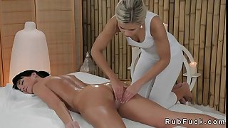 Blonde masseuse rubs and oils arse and muff of dark brown sweetheart